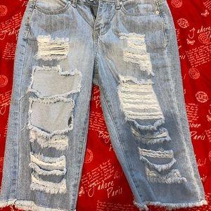 distressed long jean shorts.